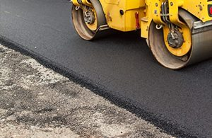Commercial vehicle with Kent Asphalt Paving laying new asphalt